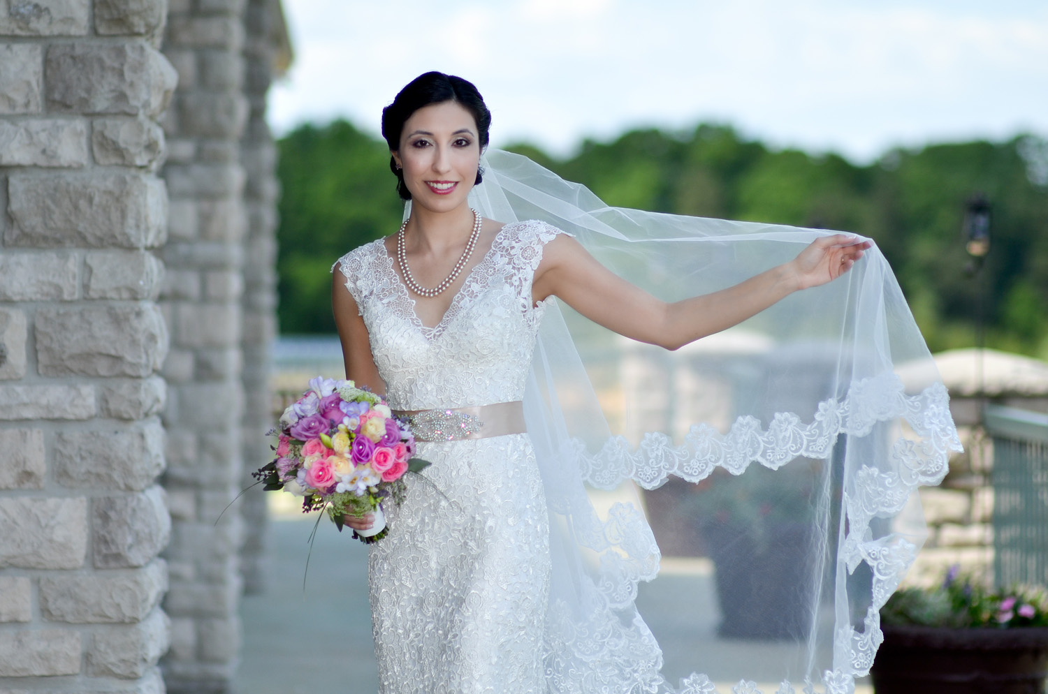 Bride on terrace at Scotland Run Golf Club / Meyer Photography