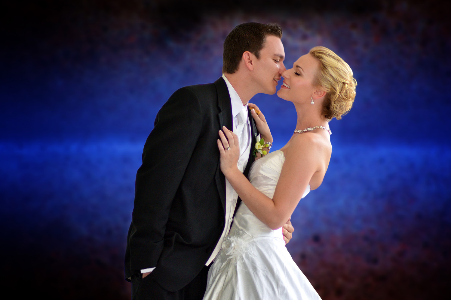 bride and groom coy embrace / Meyer Photography