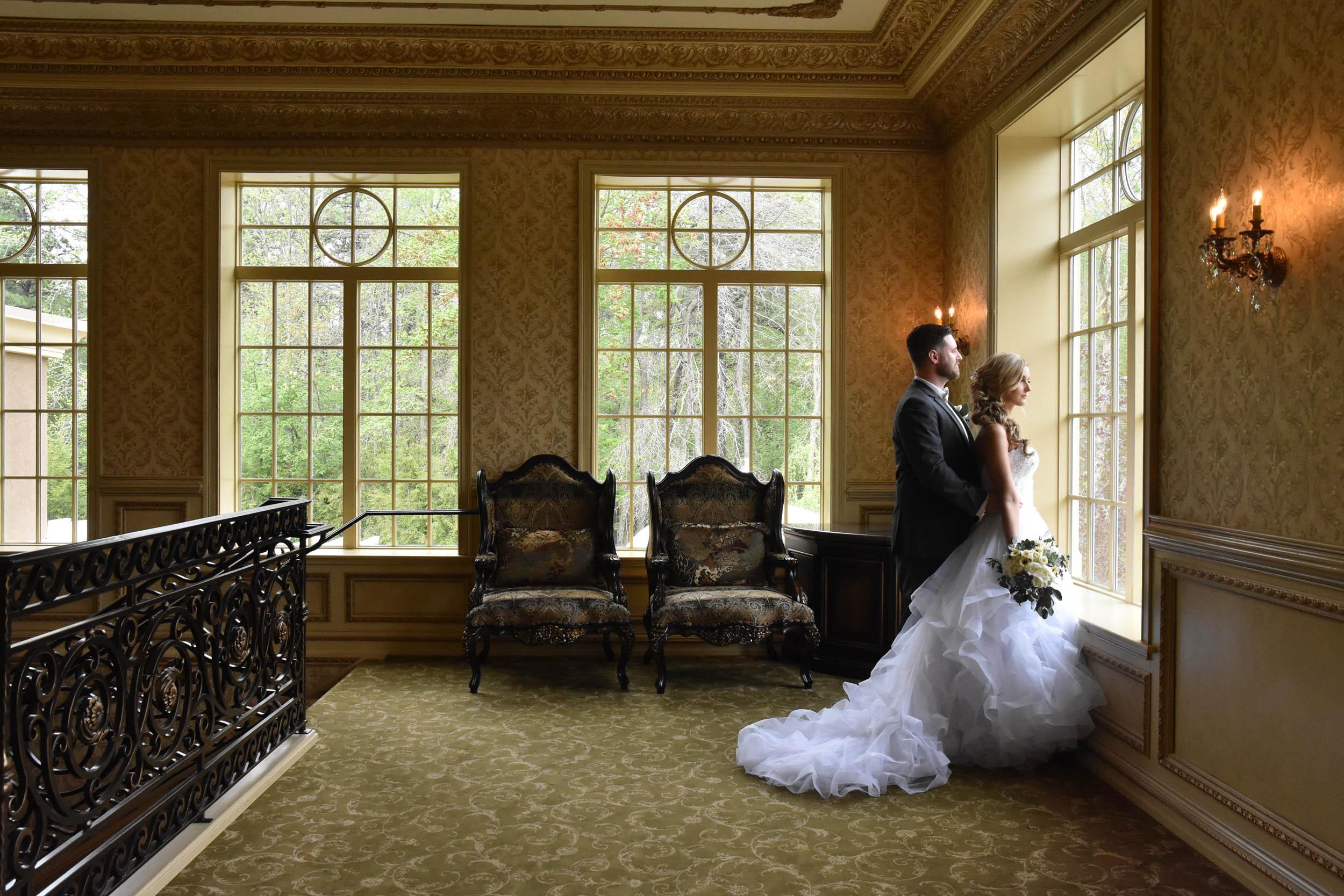 Bride and groom dramatic window at Brigalias
