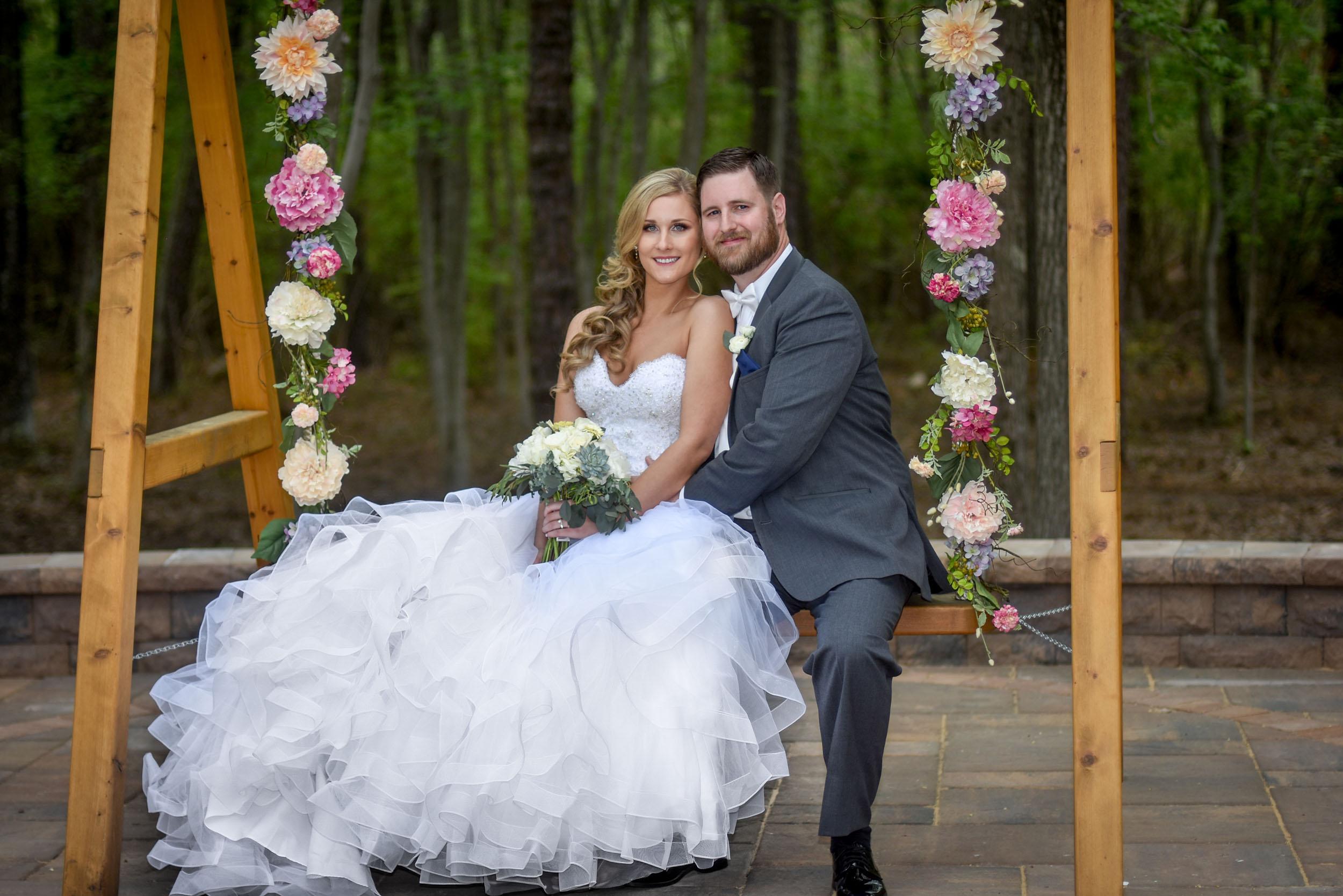Bride and groom on flower swing at Brigalias
