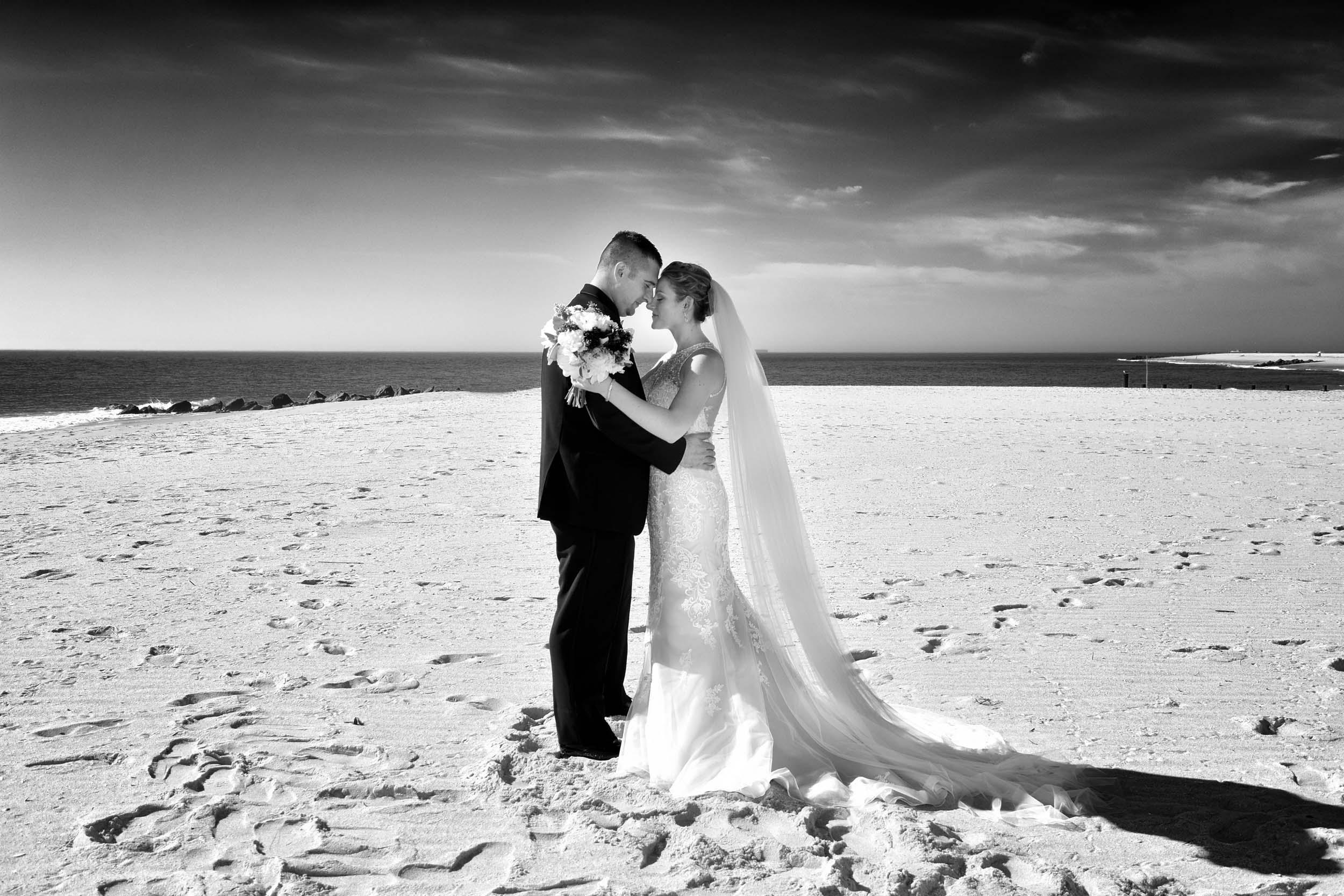 Dramatic bride and groom on beach