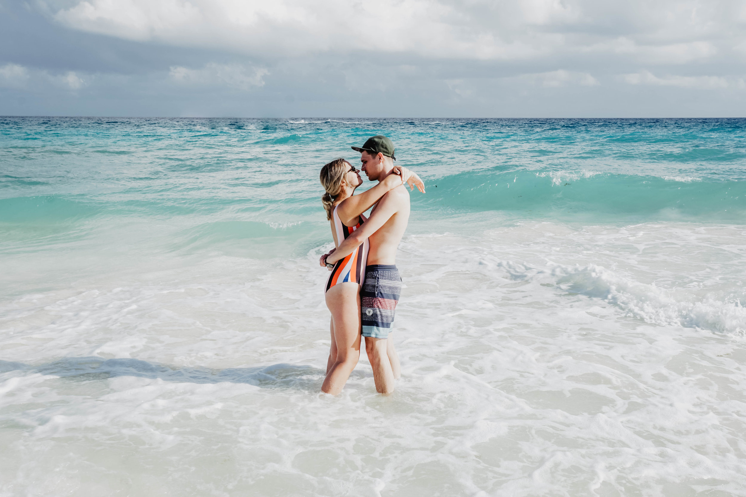 A couple on the beach at Hotel Xcaret Mexico.