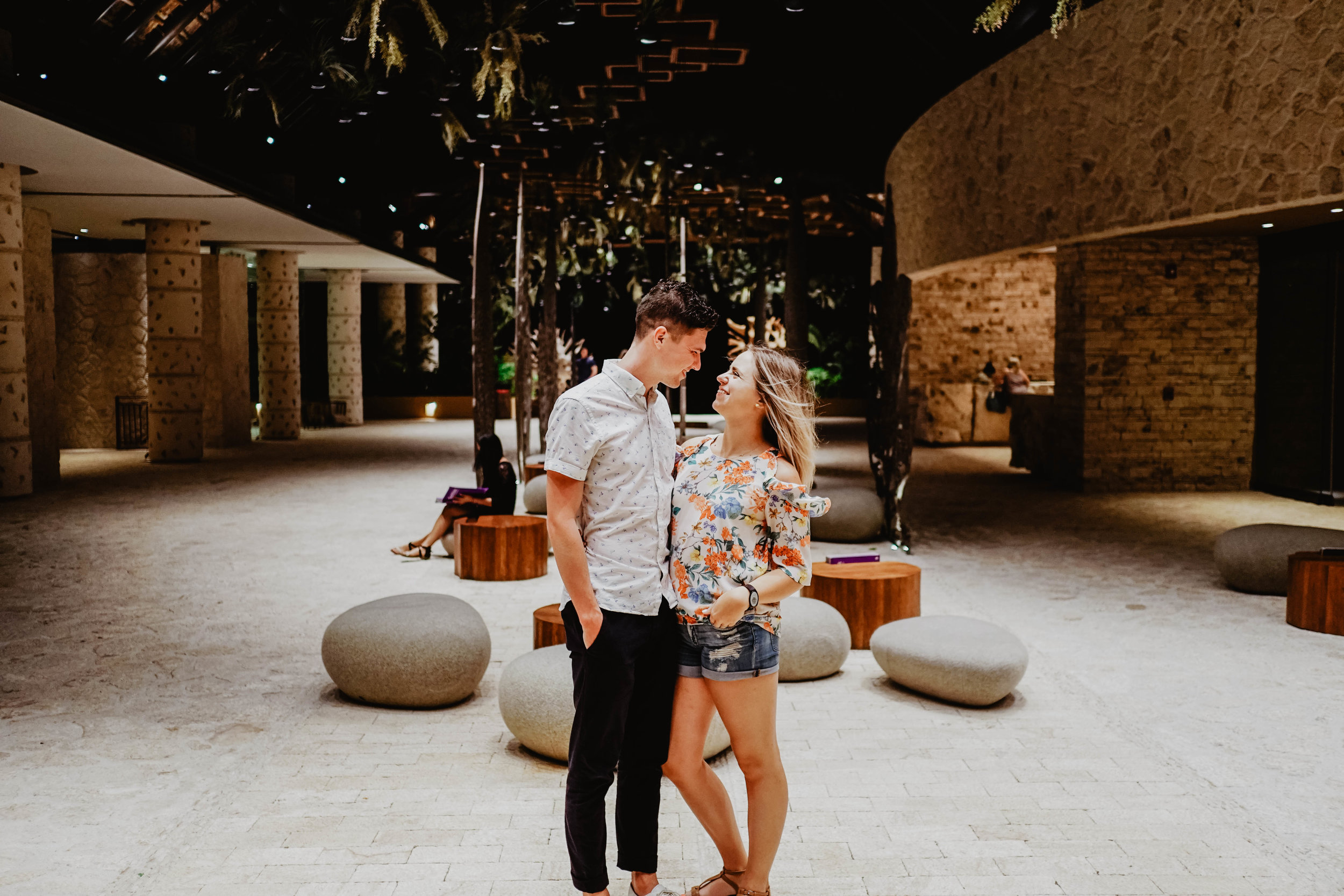 A couple posing for a photo in the lobby of Hotel Xcaret Mexico