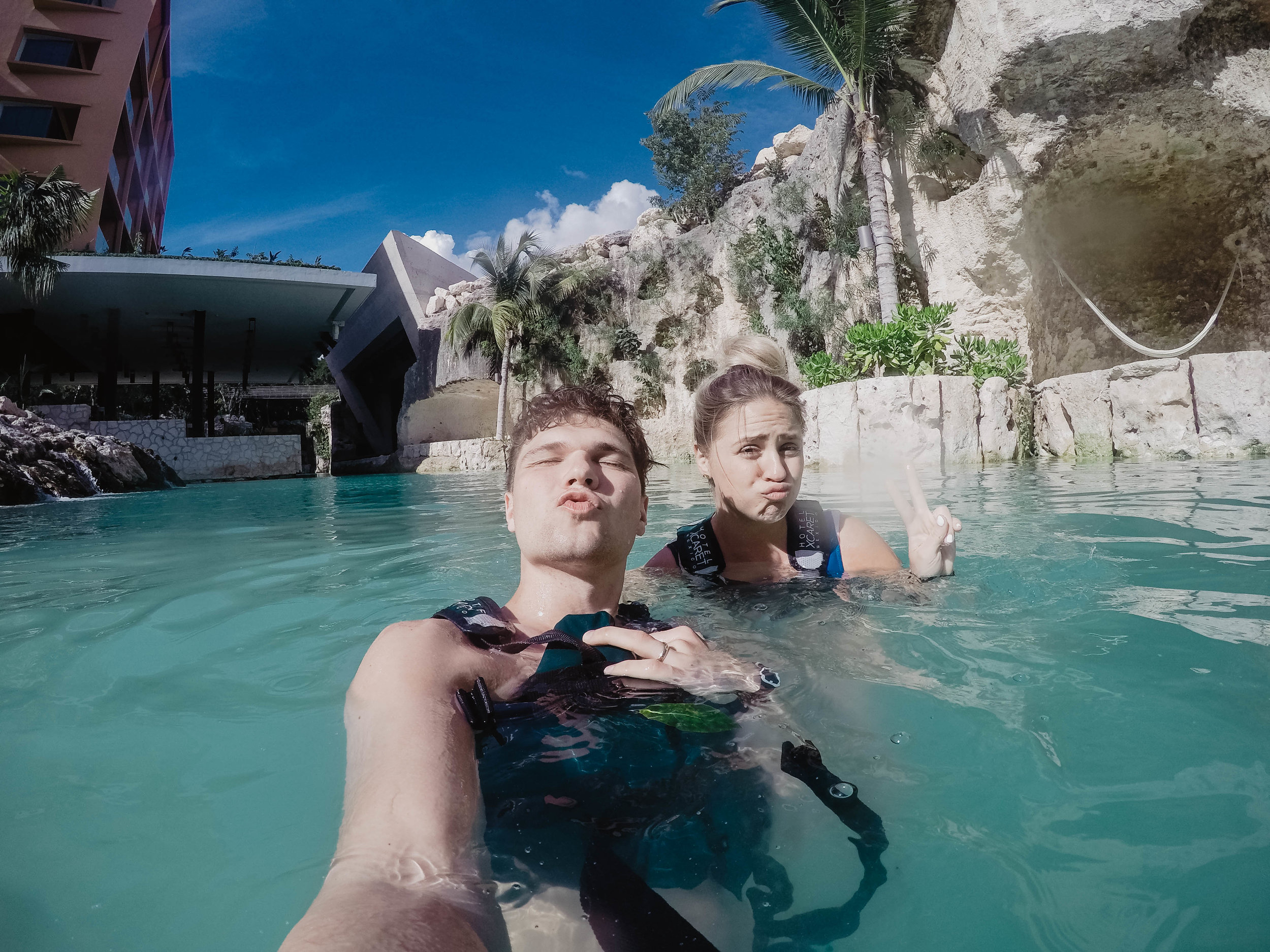 Posing for a ducklips photo in the lazy river at Hotel Xcaret Mexico