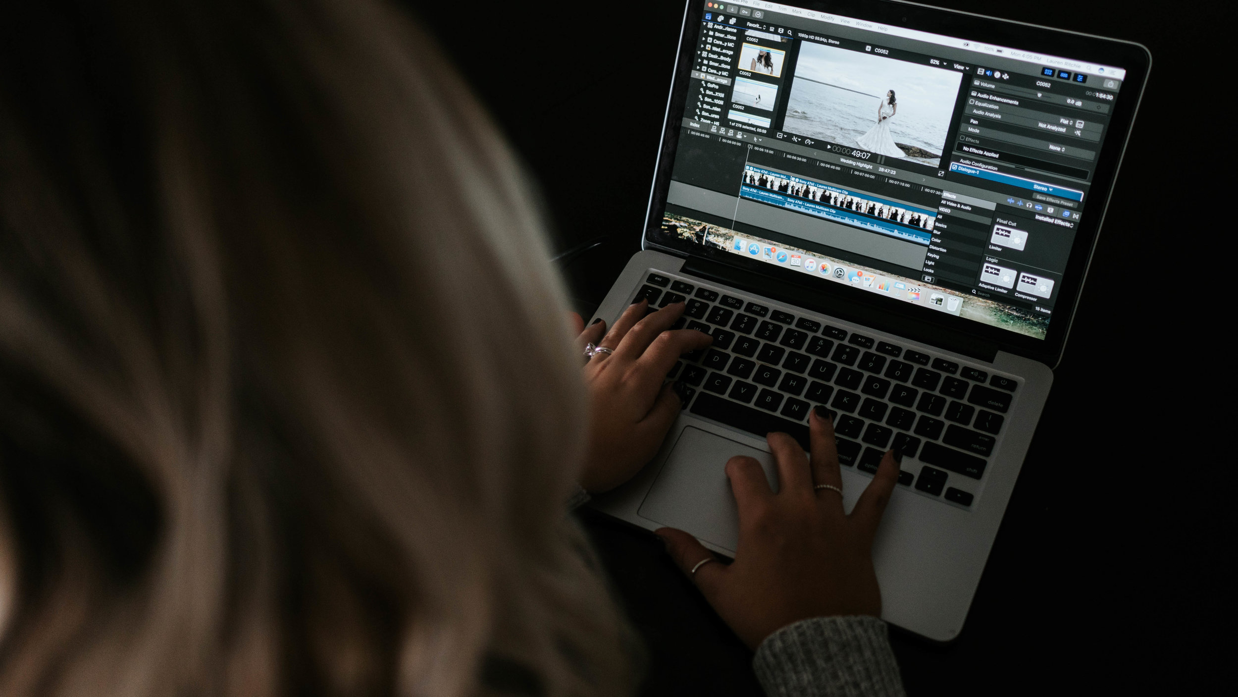 Lauren from Prairie Film Co. editing video on her MacBook Pro in Final Cut Pro X.