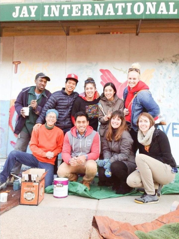 Executive Director Libby Pedersen (standing far right) and choreographer Kimberly Kavanagh (kneeling second from right) Painting boarded up buildings on South Grand after vandalism November, 2014