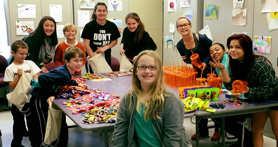 Organizing candy donations to make Halloween treat bags for residents at Epworth Child and Family Service Center in Webster Groves. More than 40 bags were created and dozen of bags of candy and Halloween treats collected by the cast ofDisney's The Little Mermaid Jr.!