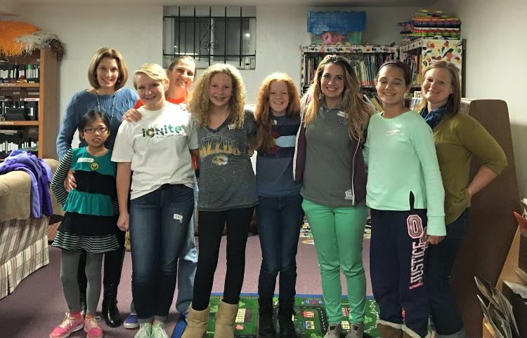 SPARKs Kira, Taylor, Angela, and Helen along with parents Mrs. Losse, Mrs. Averett, Ms. Schiller and Community Outreach Coordinator Kimberly Kavanagh plus Jr. SPARK Leya volunteering with Childcare to the residents of Our Lady's Inn Crisis Nursery and Maternity Homes in St. Louis City.