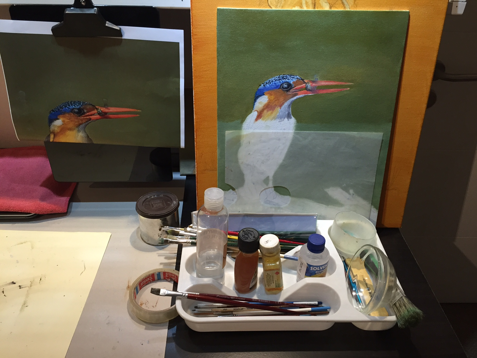 This photo shows the painting in progress against the refernce photo