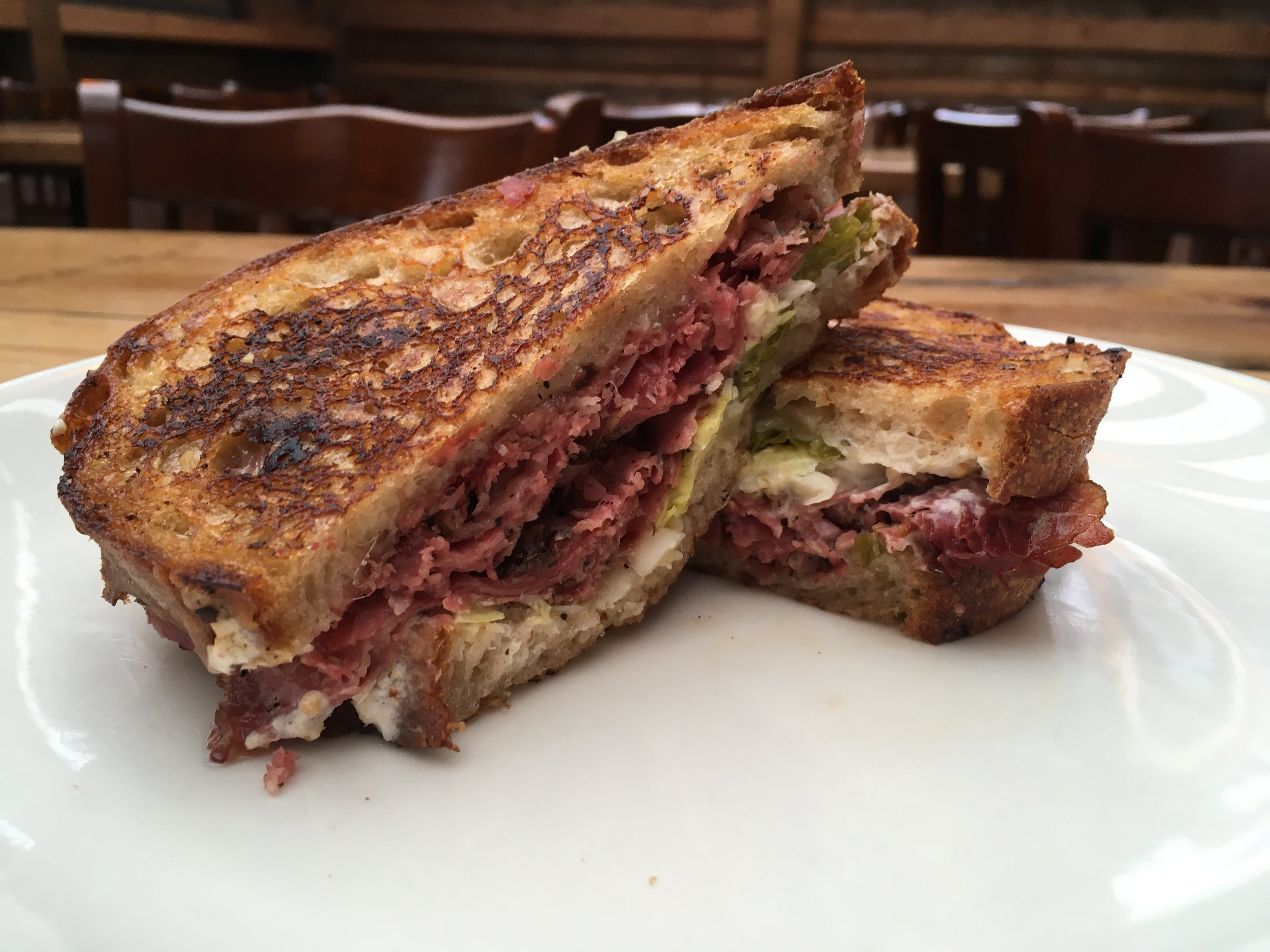reuben and a pint $12 fried cheese curds $3 drink special: dirty camping mule $6