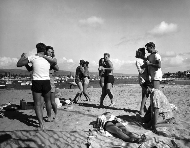 forties-fifties-sixties-love :     Peter Stackpole, Life Magazine. Glendale Junior College students dance on California's Balboa Beach in 1947