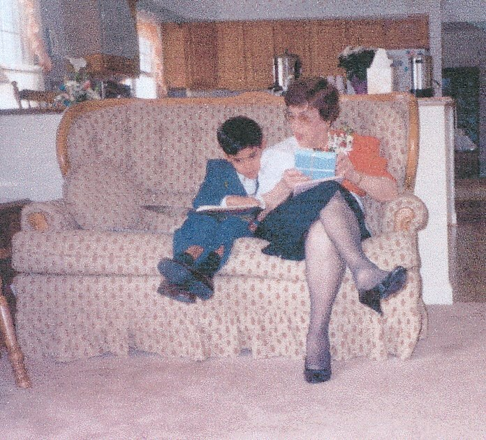 Reading with Nana on her 80th birthday.