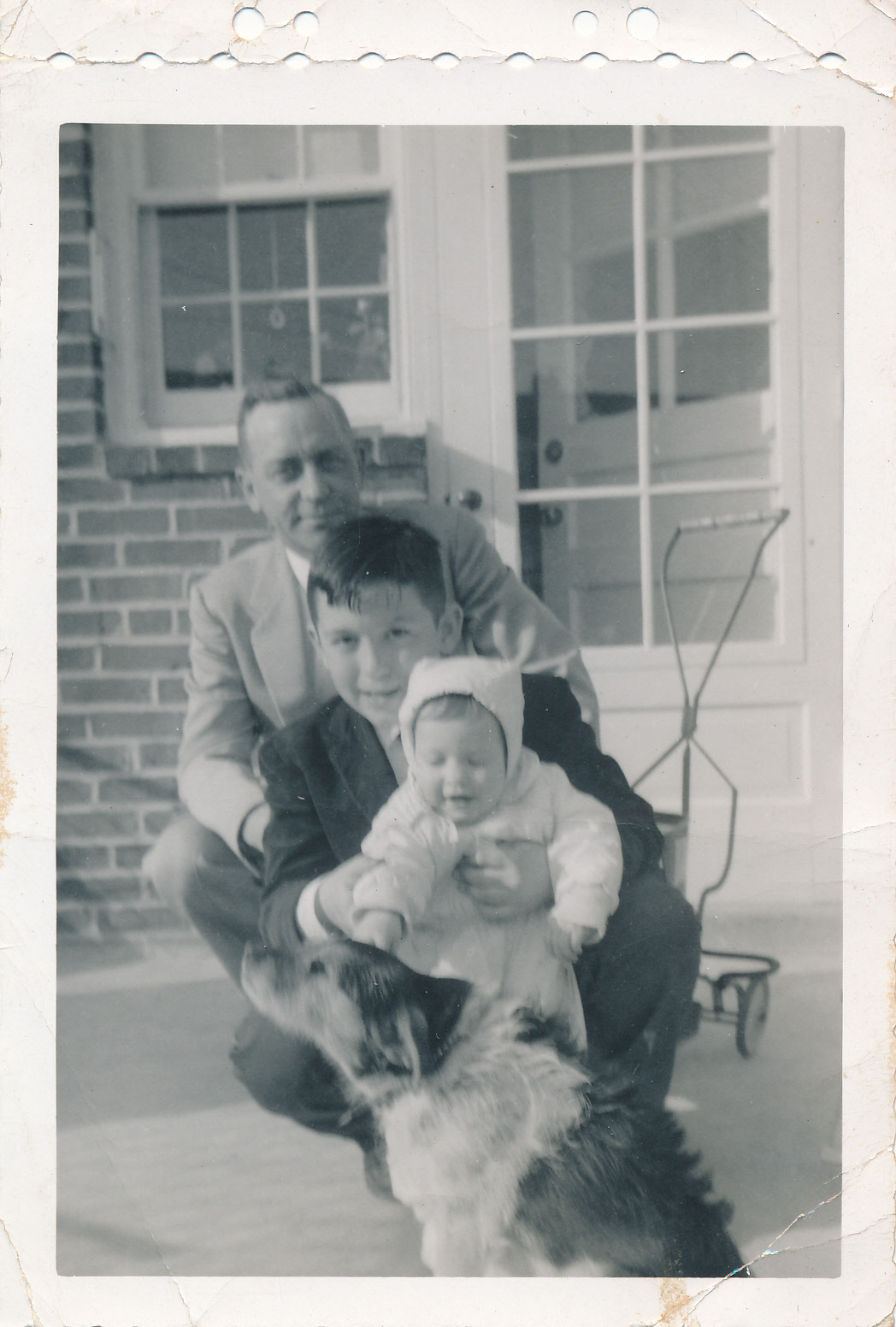 My Grandfather and Dad with Aunt Betty as a baby.