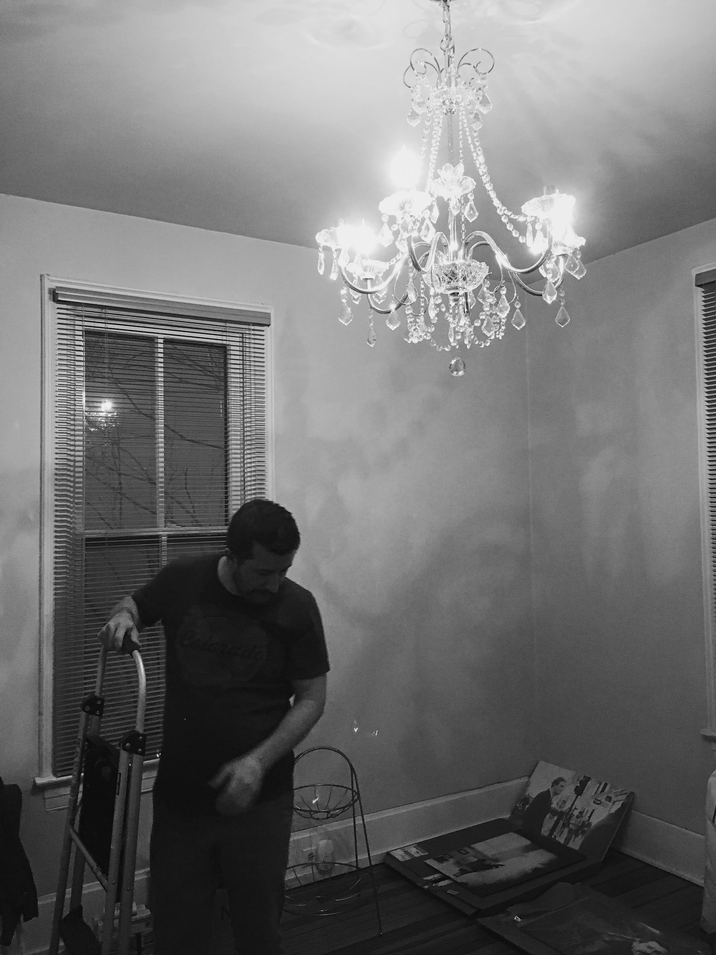 My handsome beau just after hanging the office chandelier. I guess this qualifies as a before shot...