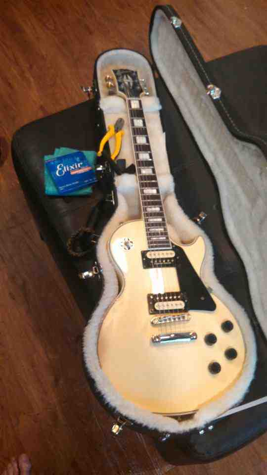 My very first Gibson 2011 Classic Custom! Had been wanting a Les Paul since I was a kid! One of many dreams come true made possible by my wife loaded with Seymour Duncan pearly gates named her Pearle courtesy of Jeff Crabbs.jpg