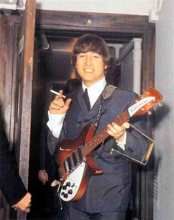 John Lennon backstage with his Rickenbacker