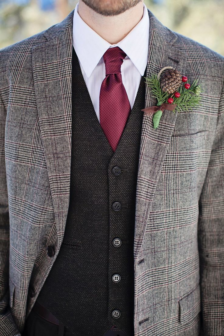 man-in-tweed-jacket-with-holly-and-pinecone-boutonniere-wedding-attire.jpg