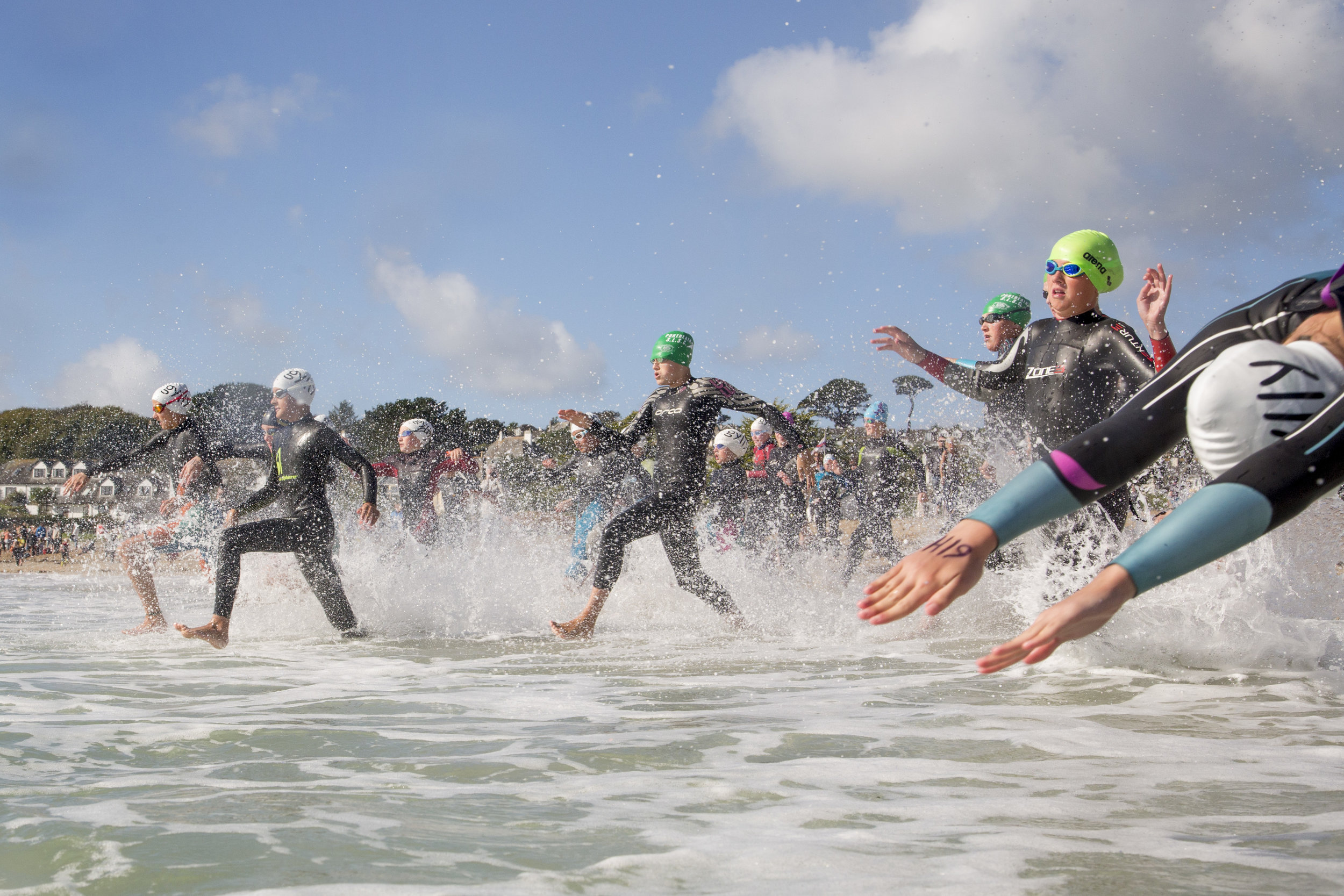 Gyllyngvase sea swimmers jumping of the start line.  Under 18 sea swimmers jumping of the start line at the Gyllyngvase   beach annual competitive swim. Gyllyngvase   beach, Falmouth, Cornwall, GB, 25/09/16