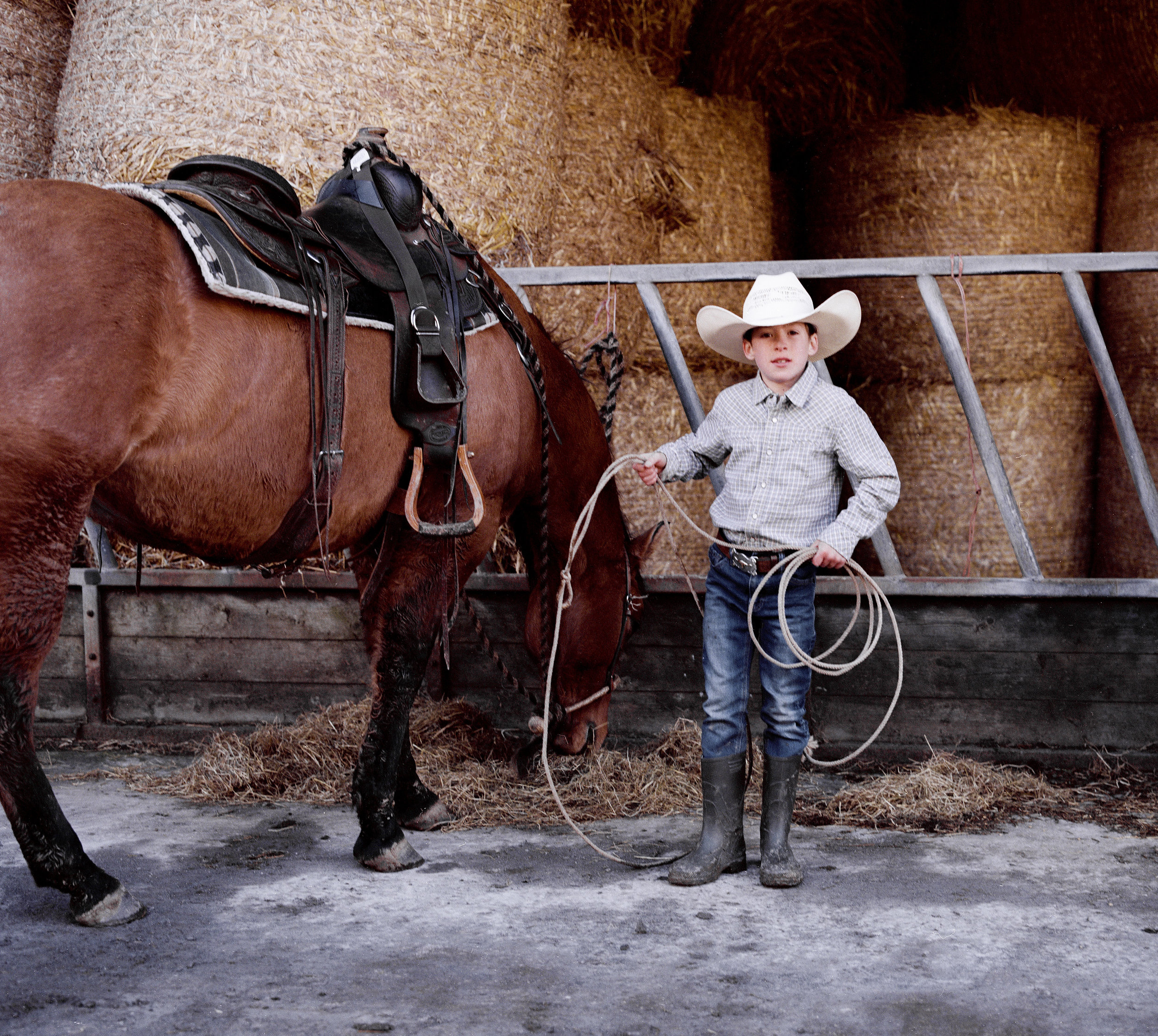 """Rueben Linscott practicing his Lassoing on his grandfathers ranch in Devon. Rueben has been taught how to ride and lasso by his grandfather Brian Rowden, who runs the western rodeo events in Devon. He currently prefers lassoing as he believes it is """"the hardest part about western riding""""."""