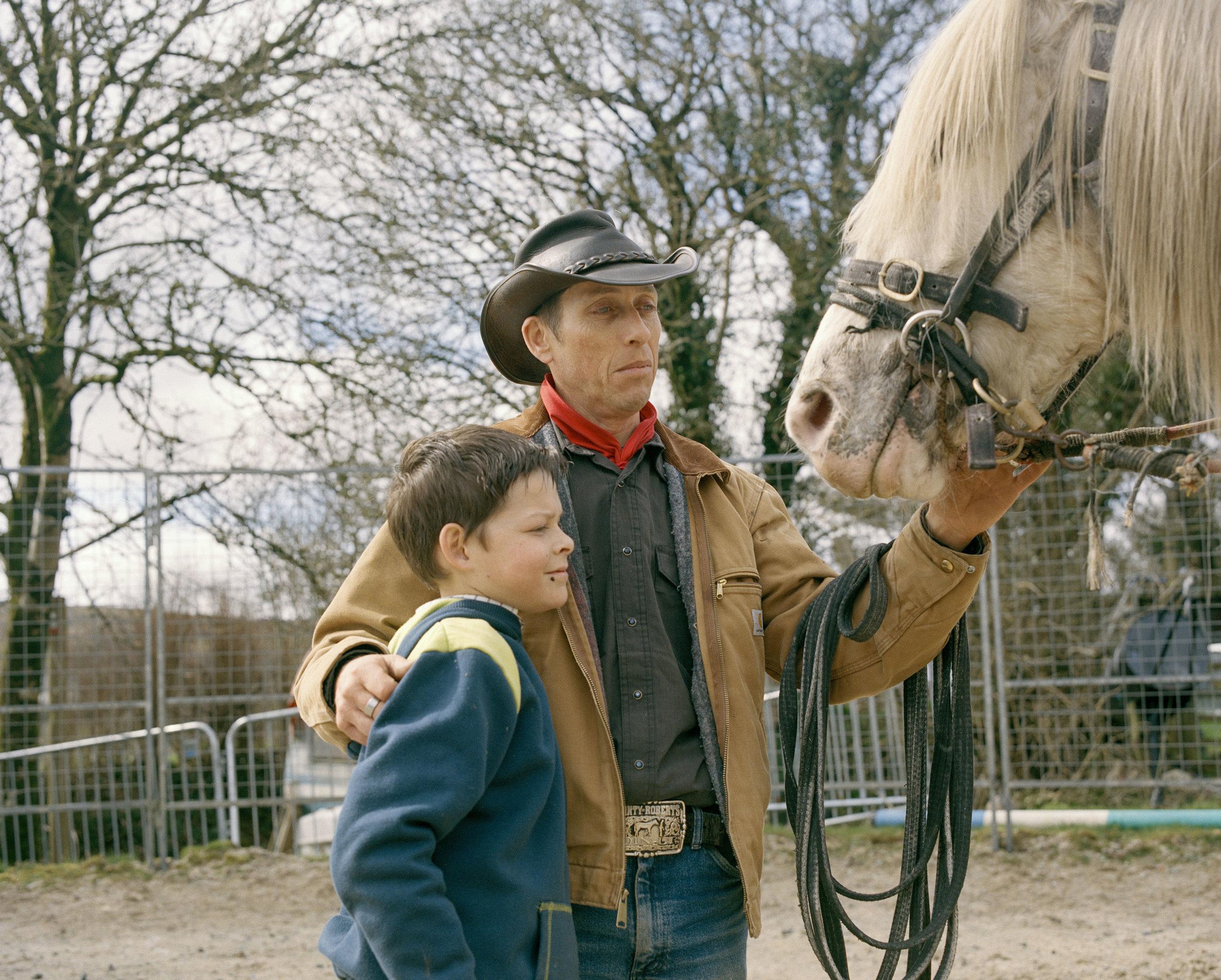 Dan Wilson and his Son, Callum Wilson getting Dan's horse ready to ride on the moor above their farm.