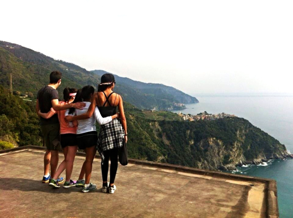 """Sharing a beautiful moment with a """"stranger""""on an abandoned rooftop we stumbled upon while hiking the hills of Italy. He quit his job in Canada to travel across Europe with no plan and no direction. // CINQUE TERRE, ITALY."""