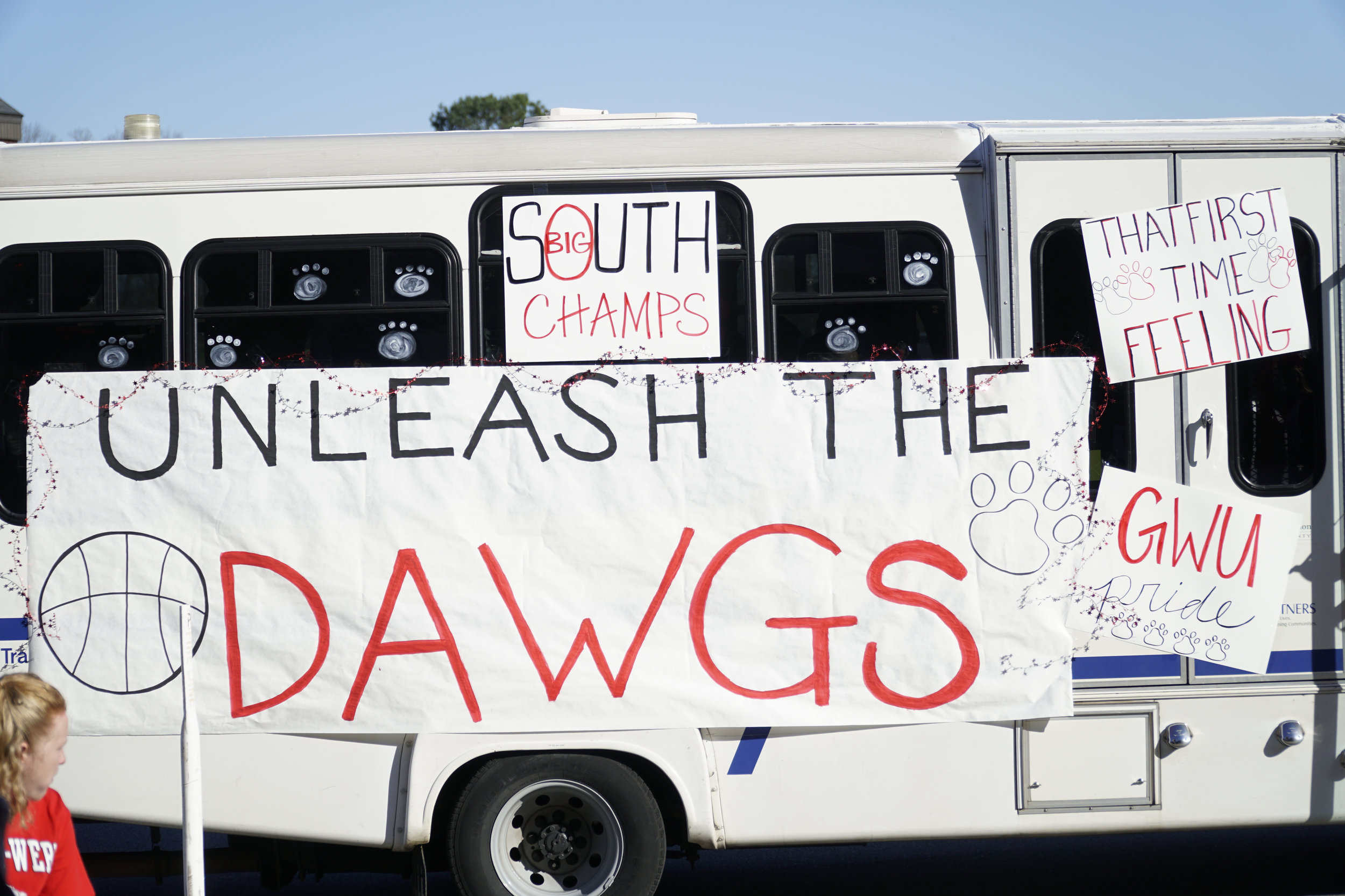 The bus that delivered the team to the Tucker Student center was decorated with signs.