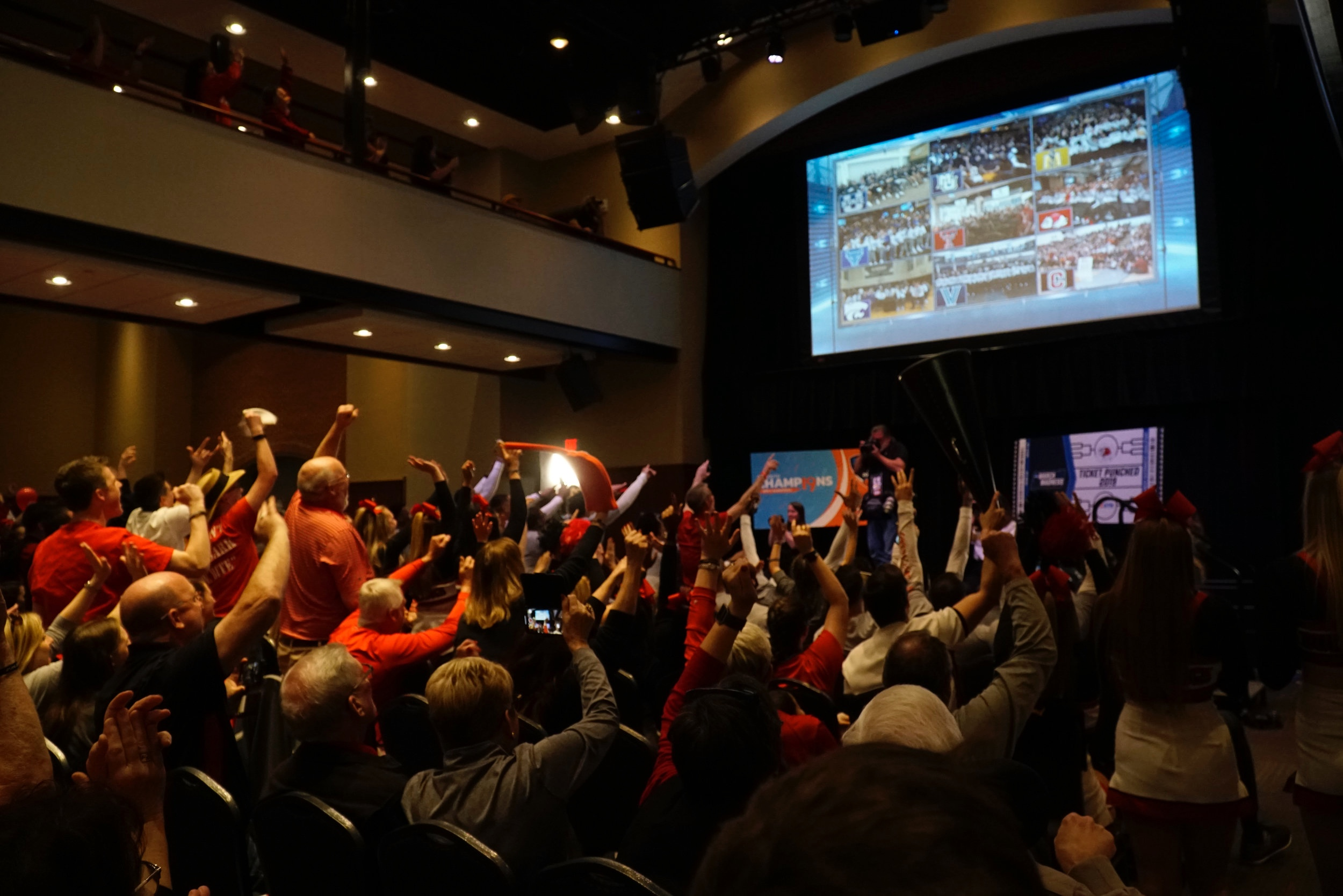 The crowd cheers as the Live Look at GWU appears on the screen.