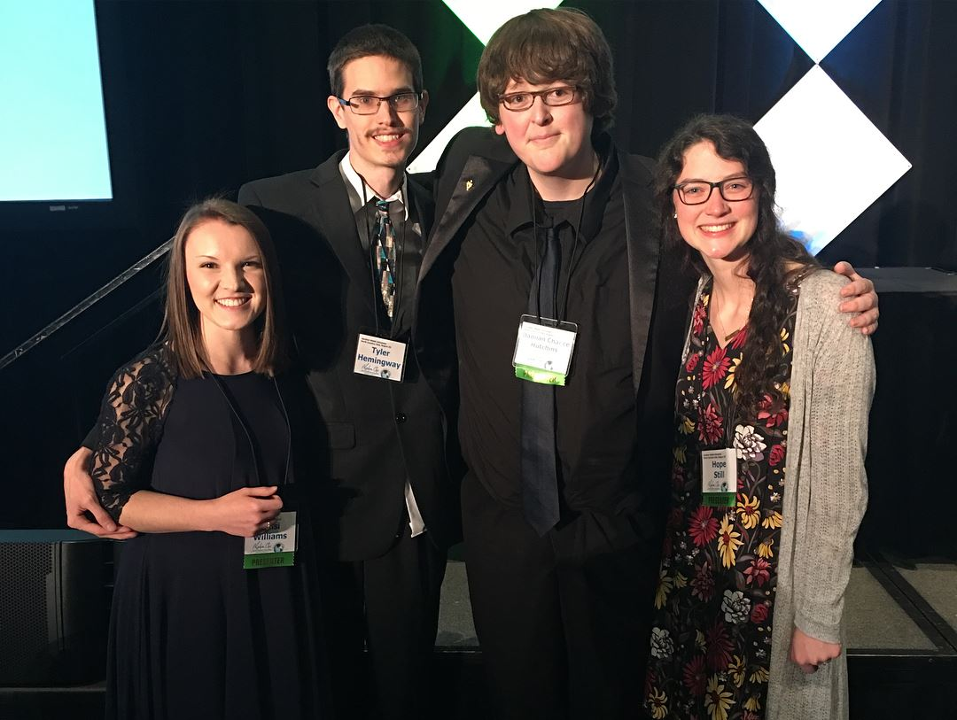 Damian (second from right) and other members of GWU's Alpha Chi Honors society at the Alpha Chi National Convention in 2018.