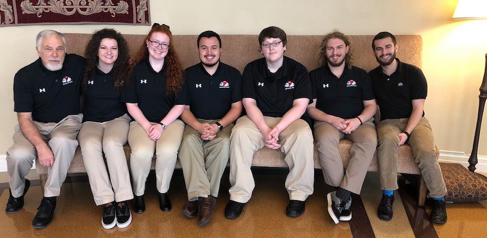 Damian (third from right) with the 2019 Honors Quiz Bowl team. He was team captain.