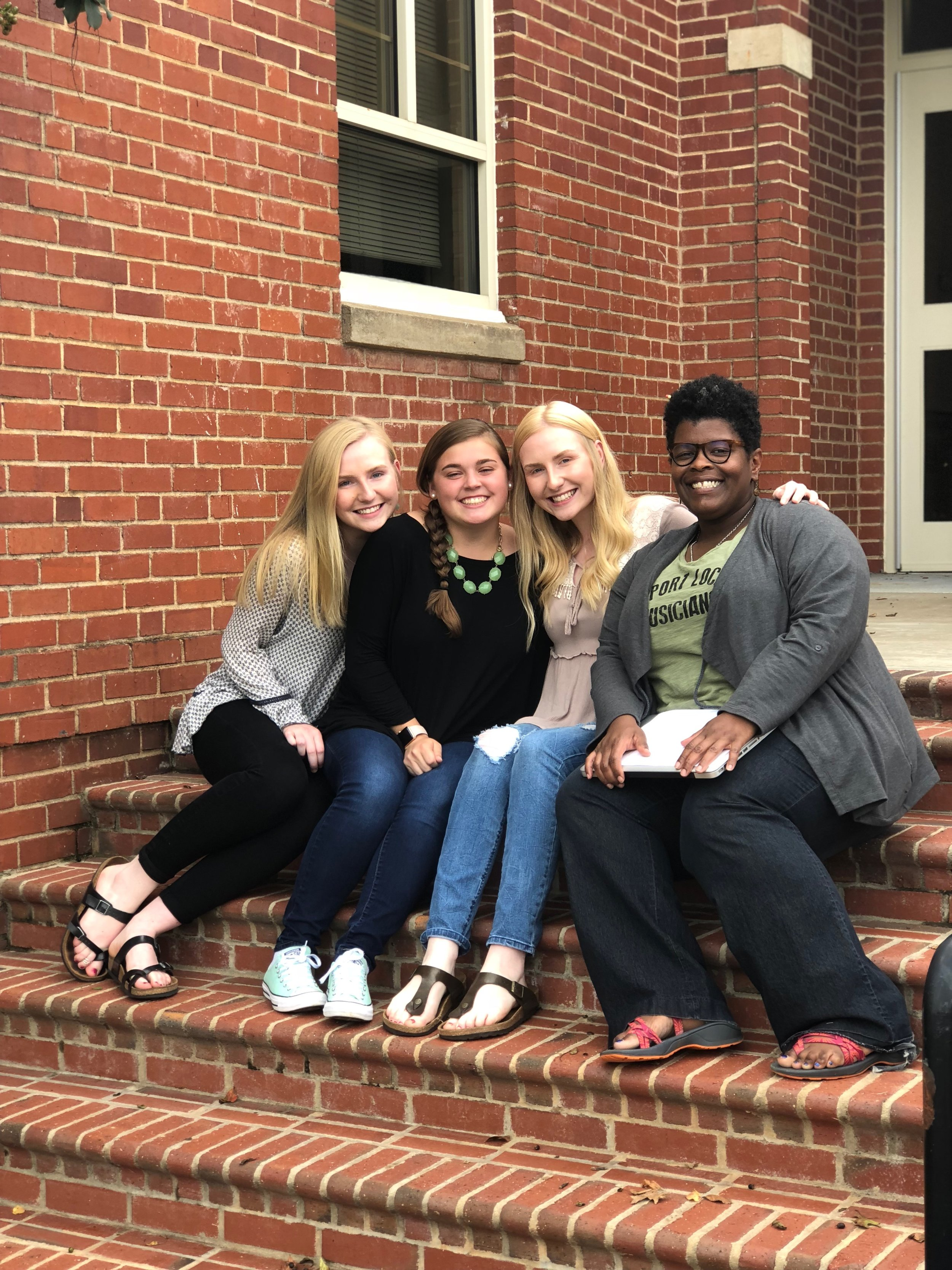 Madeline (second from left) with classmates and Professor Jondra Harmon (right).