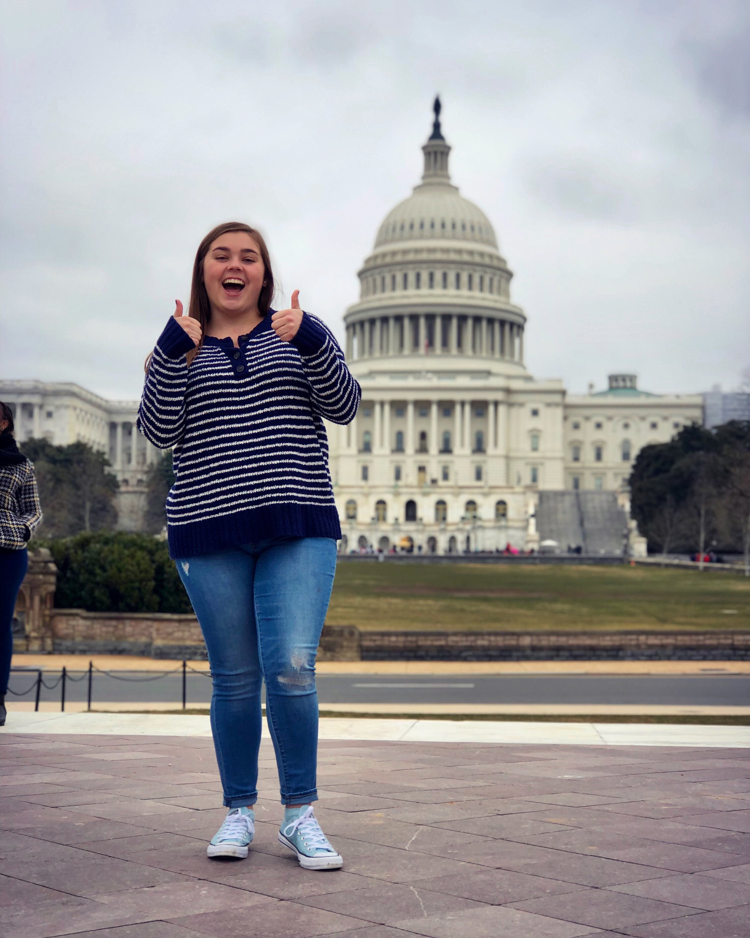 Madeline posing in front of the US Capitol Building during the 2019 Concert Choir Tour.