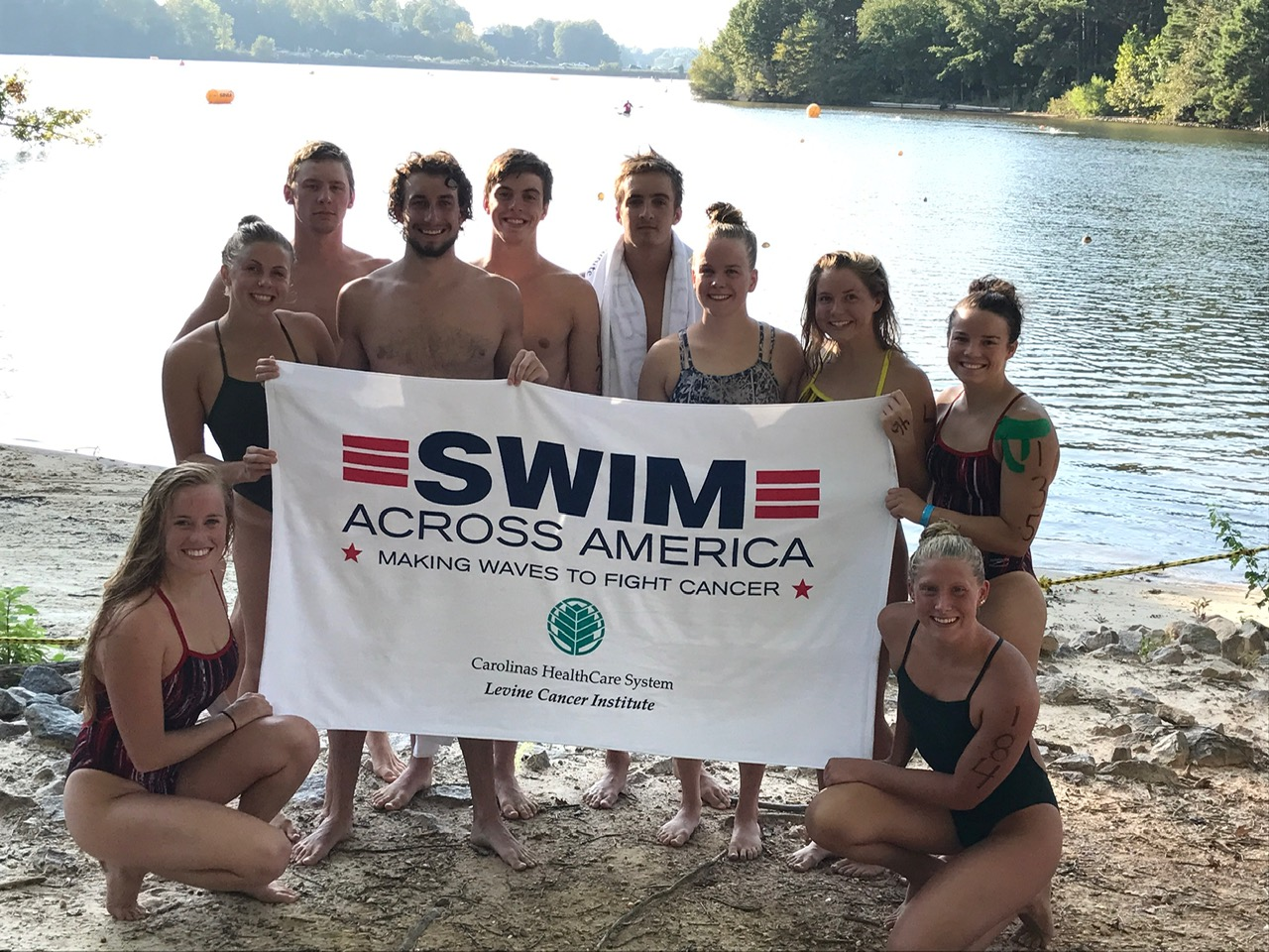 Morgan with a  group of GWU Swim Team members that participated in the swim Across America event at Lake Norman, North Carolina.