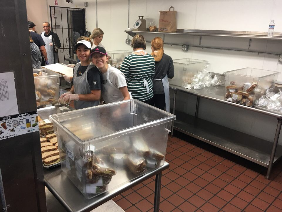 One of my best friends, Tori, an alumnus of GWU, preparing lunch with me and our group at the homeless shelter in San Francisco, California.