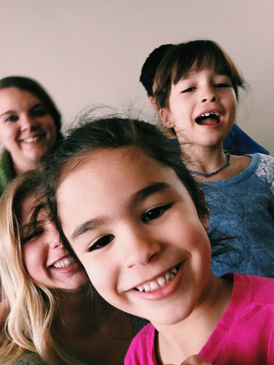 Miranda and Trista Riddle, another member of the missions team, with the children they tutored.