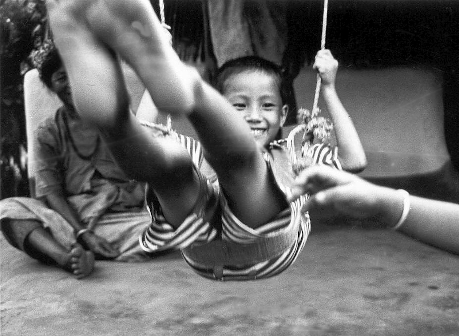 Playing happily on a swing   Here I am a refugee but I do not want refuge. I want the wings to fly. (c) Aita Maya / Rose Class / PhotoVoice