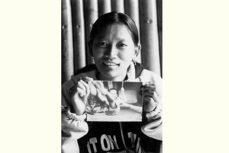 Aite Maya with her photograph, Kathmandu exhibition 2002