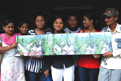 Bhutanese youth show one of their panoramic images of the camp, 2007