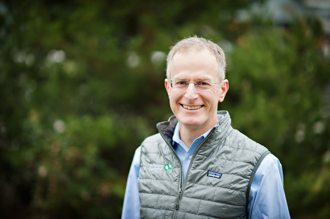 "Meet Mike, an innovative conservation leader and the director for The Nature Conservancy's Washington Chapter.   He brings 20 years of experience in land and wildlife conservation, conservation biology, and leadership and management of conservation and business organizations to his work in Washington. He and his wife Liz have just moved from Idaho to the Phinney Ridge neighborhood of Seattle.  In the Seattle office, we caught up with Mike for a Q&A:   nature.org:   Why does nature matter to you?   Mike Stevens:   I grew up in Spain and some of my earliest memories are of visits to the countryside and the beach – nature was about family and food. We spent two summers with friends in Finland – I was free to ride my bike through the woods all day; our meals were fish from the lake and vegetables from the garden. We moved to Santa Barbara when I was 11 and our family spent a lot of time exploring  California  and especially Yosemite and the eastern Sierra. There, I learned that nature offered challenge and inspiration and I was introduced to the region's rich history of conservation.   nature.org:   What do you think is the most exciting new idea in conservation?   Mike Stevens:   I think the most exciting idea in conservation is also in a sense the oldest: how are we as people going to live and thrive in relationship to nature?  There are so many exciting ways in which we are reshaping how we fish, cut trees, raise food, and protect our water and air . This region is already having conversations about and taking action in many of these areas, which was a huge draw for me.   nature.org:   What do you think are the most urgent issues facing us, locally and globally?   Mike Stevens:   The number of people on Earth is growing and we are collectively using more and more of the planet's resources. So, first, we need to be creative about how  we use and care for our natural resources so they can continue to sustain us all  – this is not just a scientific issue; I believe it's the fundamental social issue of our time. Second, we need to save room for wild nature – orcas, elephants, and  sandhill cranes  – not only for their own sake but also for the many ways they enrich our lives. Last, but certainly not least, I look forward to the challenge we have right here in our own backyard—the failing health of our beloved Puget Sound. Most folks think our beautiful estuary is in excellent health. We must join together to help heal it.   nature.org:   Why should people get involved with The Nature Conservancy?   Mike Stevens:   The Nature Conservancy leads and supports many of the most creative, collaborative, and effective efforts to tackle these issues around the world by bringing together individuals, companies, tribes, and government agencies to make lasting change. Being a part of The Nature Conservancy – as a donor, member, volunteer – is inspiring and fun as well as incredibly important.   nature.org:   What's so special about Washington?   Mike Stevens:   Washington has it all – ocean, rivers, big mountains,  forests  and sagebrush steppe. We have wilderness and big cities,  salmon  and sage grouse. Due to our geographical location and economic connections, we are linked to Canada, Asia and the world. Environmental issues are a priority for many of the people in this region and part of the local culture,  so we have an opportunity to work together make a bigger impact than what individual actions can do alone . This is possible since the Washington Chapter has a talented and committed staff and board, many passionate members and a long history of conservation success and innovation.   nature.org:   Tell us about proposing to your wife on Mount St. Helens?   Mike Stevens:   Liz and I hiked with a group of friends to the summit on a warm sunny day, ate lunch with views of Mt. Rainier and Mt. Adams, and then skied spring snow all the way back to the base. Of course, the most important part is that she said, ""Yes."" It was a perfect day."