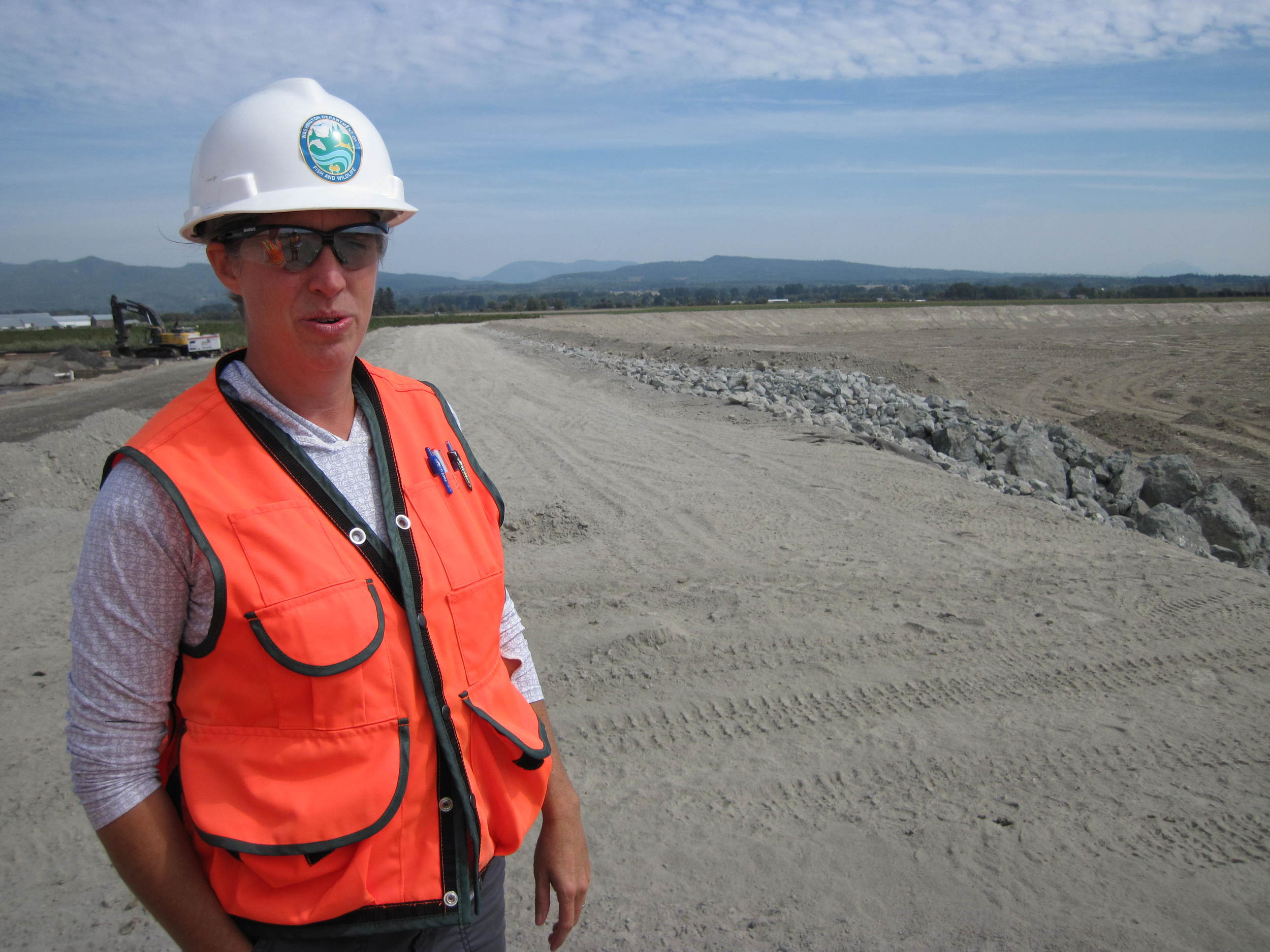 WDFW Project manager, Jenna Friebel, standing on the new setback dike in 2015 (photo by Jenny Baker, TNC)