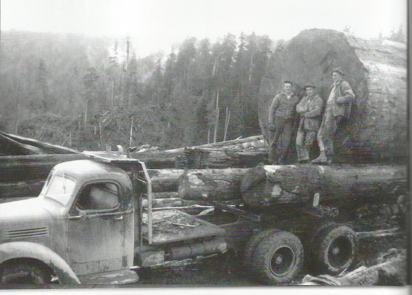 """Brix loggers in Ellsworth during the 1940's. Left to right: Johnny Bighill, Art Paavola, and Arvin Simukka. Photo from """"When Logging Was Logging: 100 Years of Big Timber in Southwest Washington"""" 2011. Appelo Archives Center."""