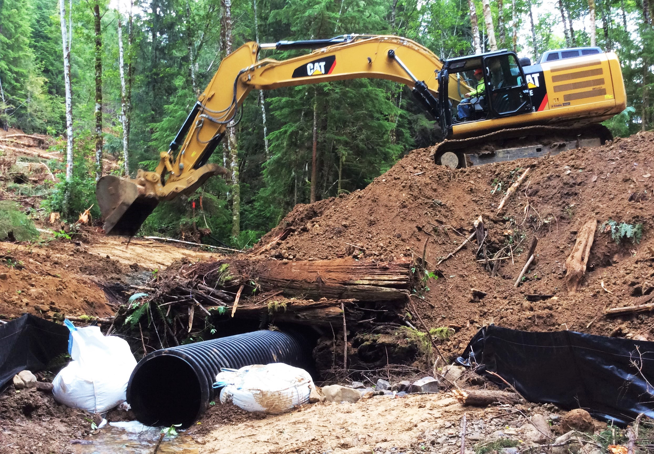 In conjunction with seasonal and weather related timing restrictions, a coffer dam was installed to mitigate potential impacts to Ellsworth Creek.