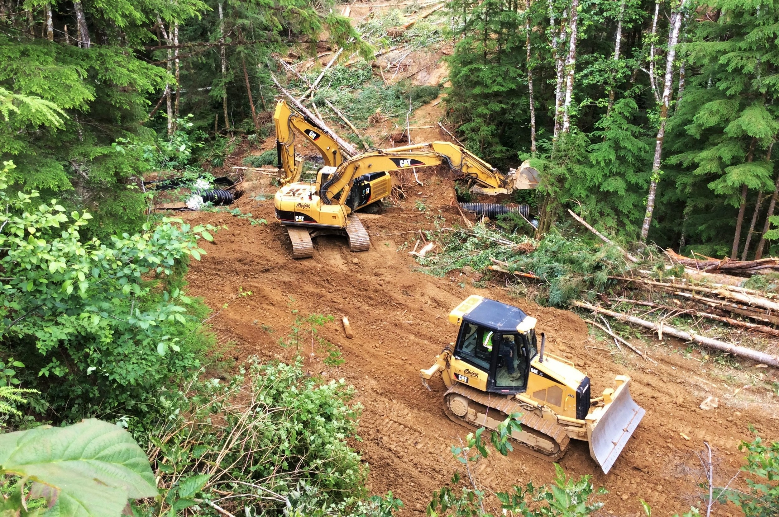 Two excavators, a bulldozer, and an off-road haul truck (not pictured) were used to do the work.