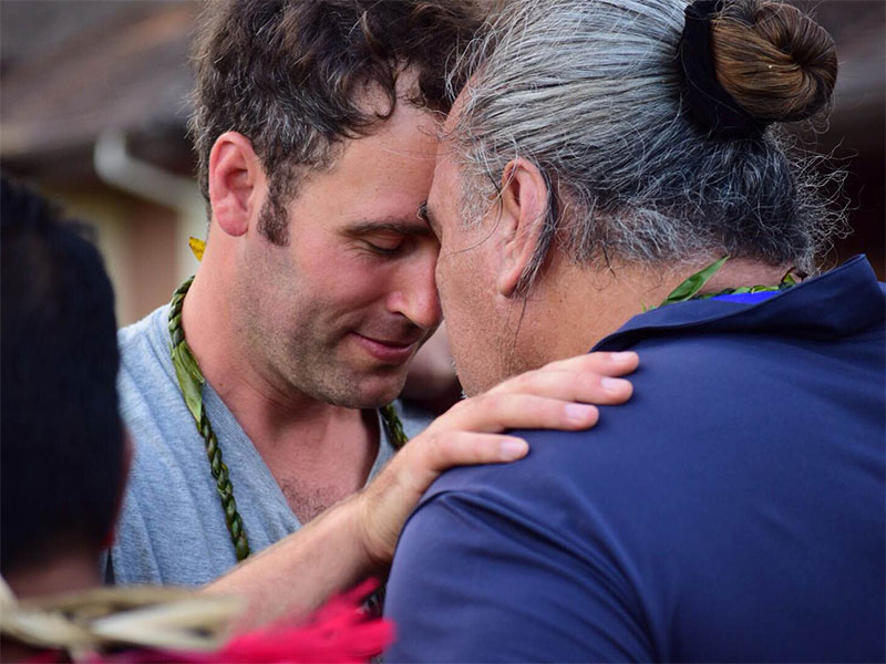 TNC Canada's Michael Reid greets another participant in the traditional Hawaiian way, touching foreheads and sharing a breath.