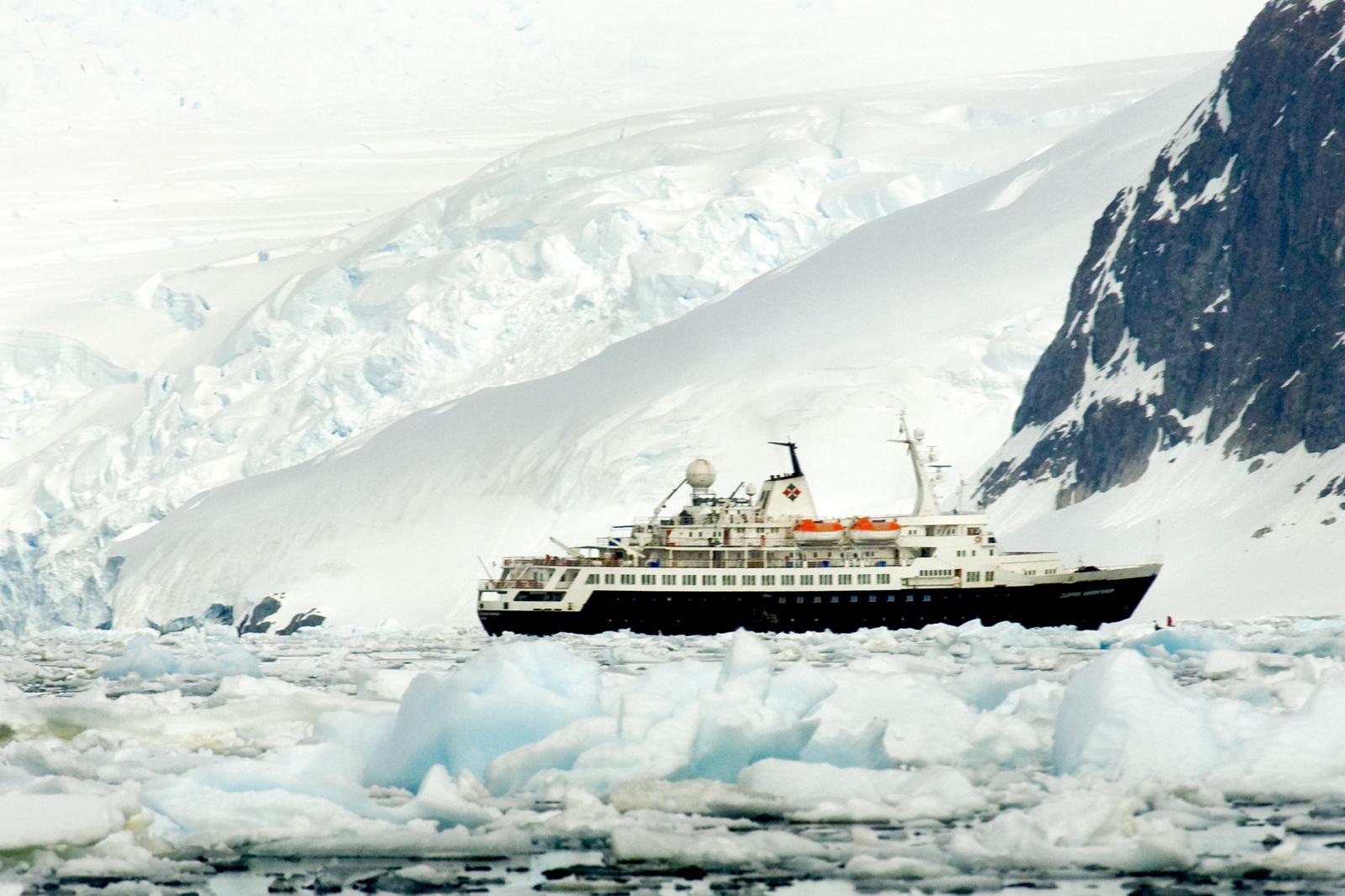 A ship at Pleneau Island off the coast of Antarctica.(Photo © Rick McEwan).