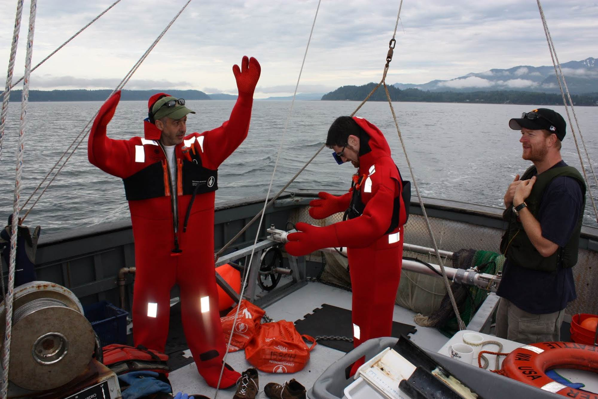Phil Levin, pictured at left, on a boat on the Hood Canal for an emergency drill. This National Oceanic and Atmospheric Administration research effort was evaluating the effects of septic systems on health of the marine ecosystem.. Photo courtesy of Phil Levin.