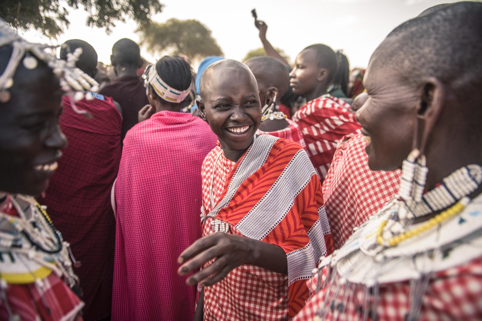 Maasai women watching Maasai men performing traditional dance in 2015.Photo credit: © Nick Hall