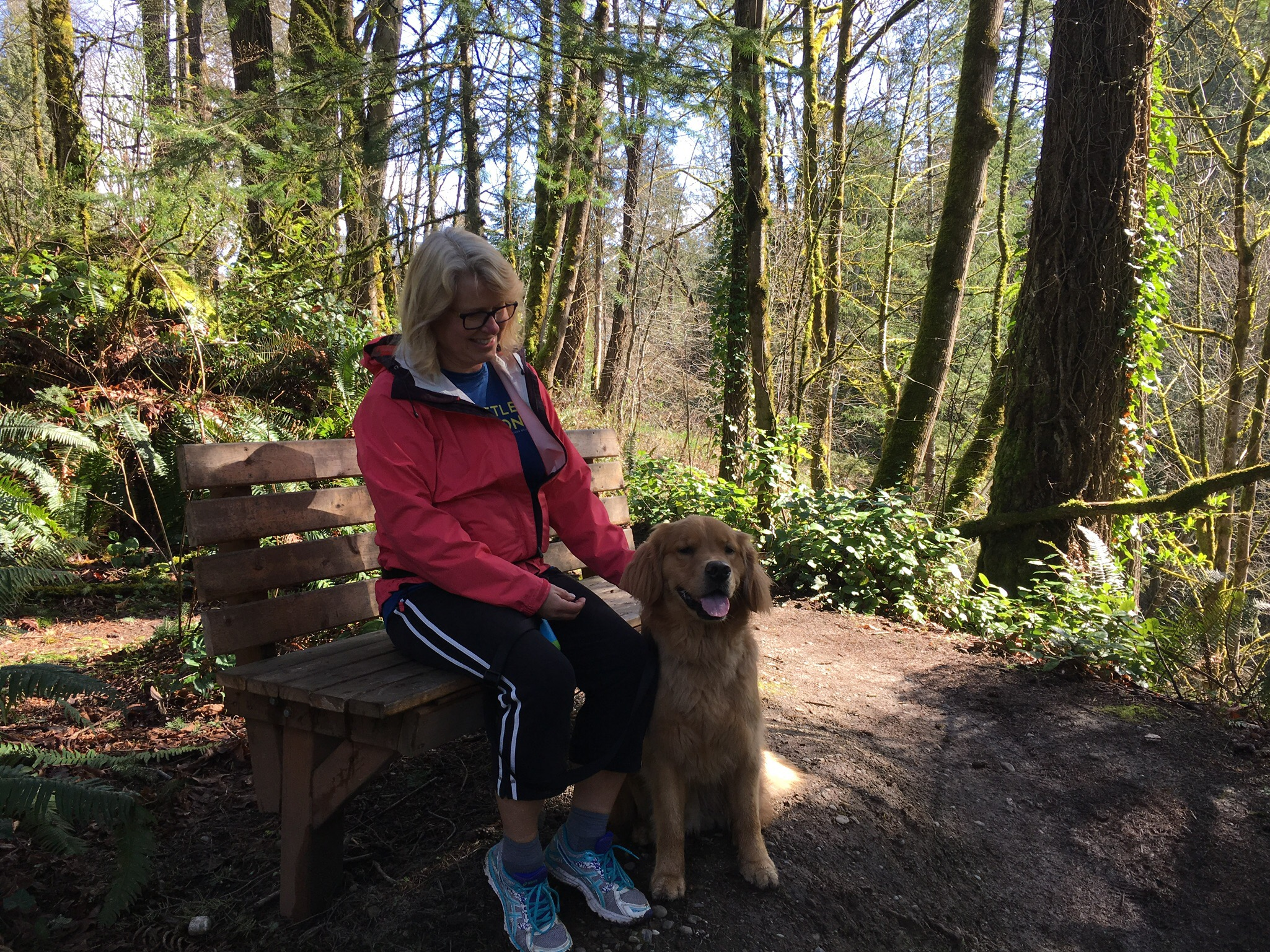 Wooden benches dot the trail, perfect for reflection--by humans and canines alike! Photo by Carrie Krueger.