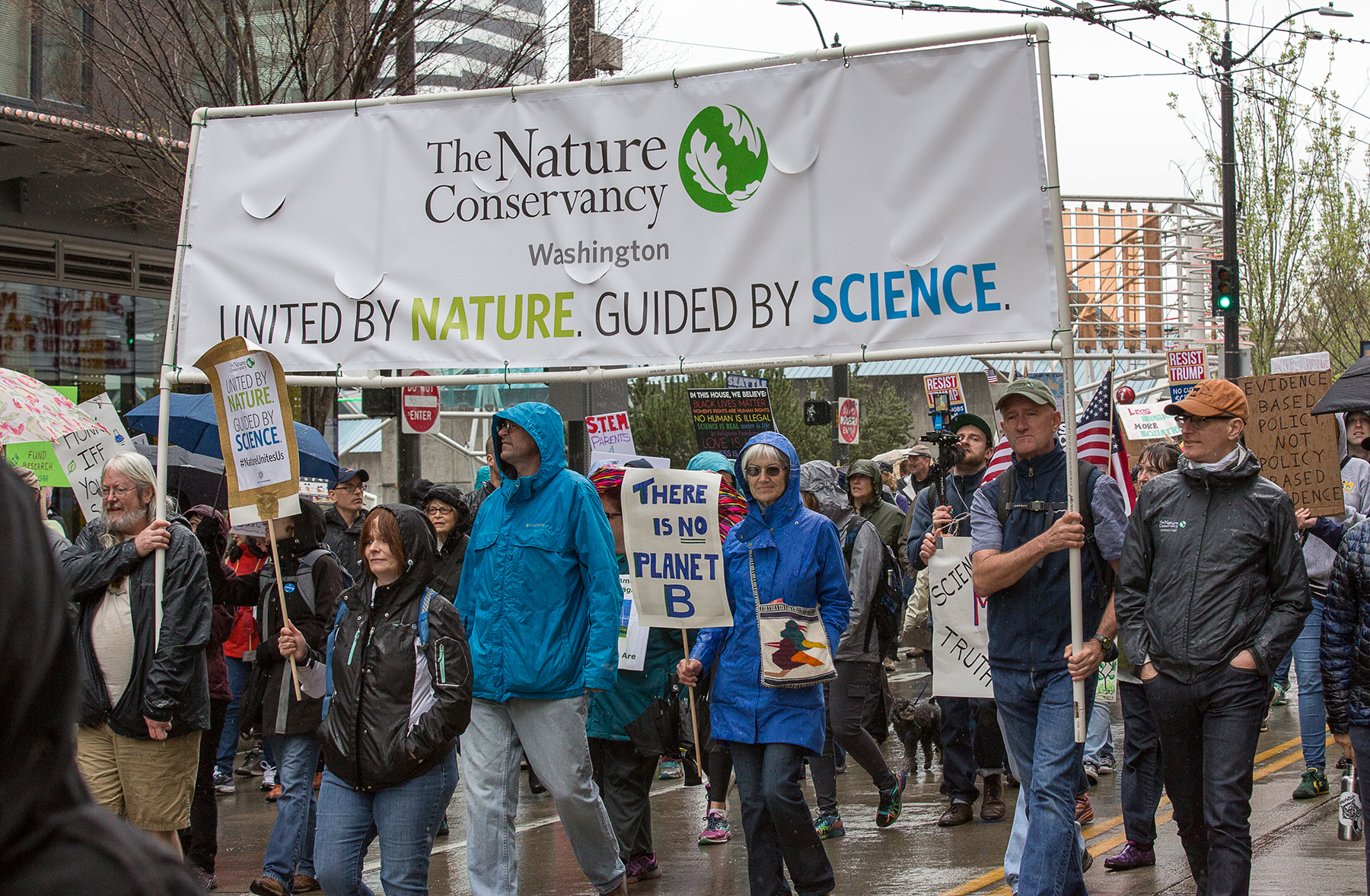 Nature Conservancy staff carry our banner at the April 22 March for Science. Photo by Douglas King.