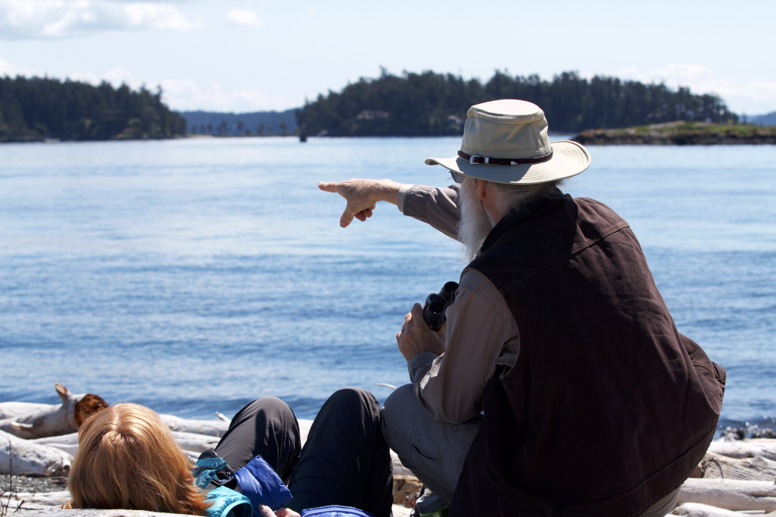 A Yellow Island visitor points out to Wasp Passage near Yellow Island. Photo by Sean Galvin.
