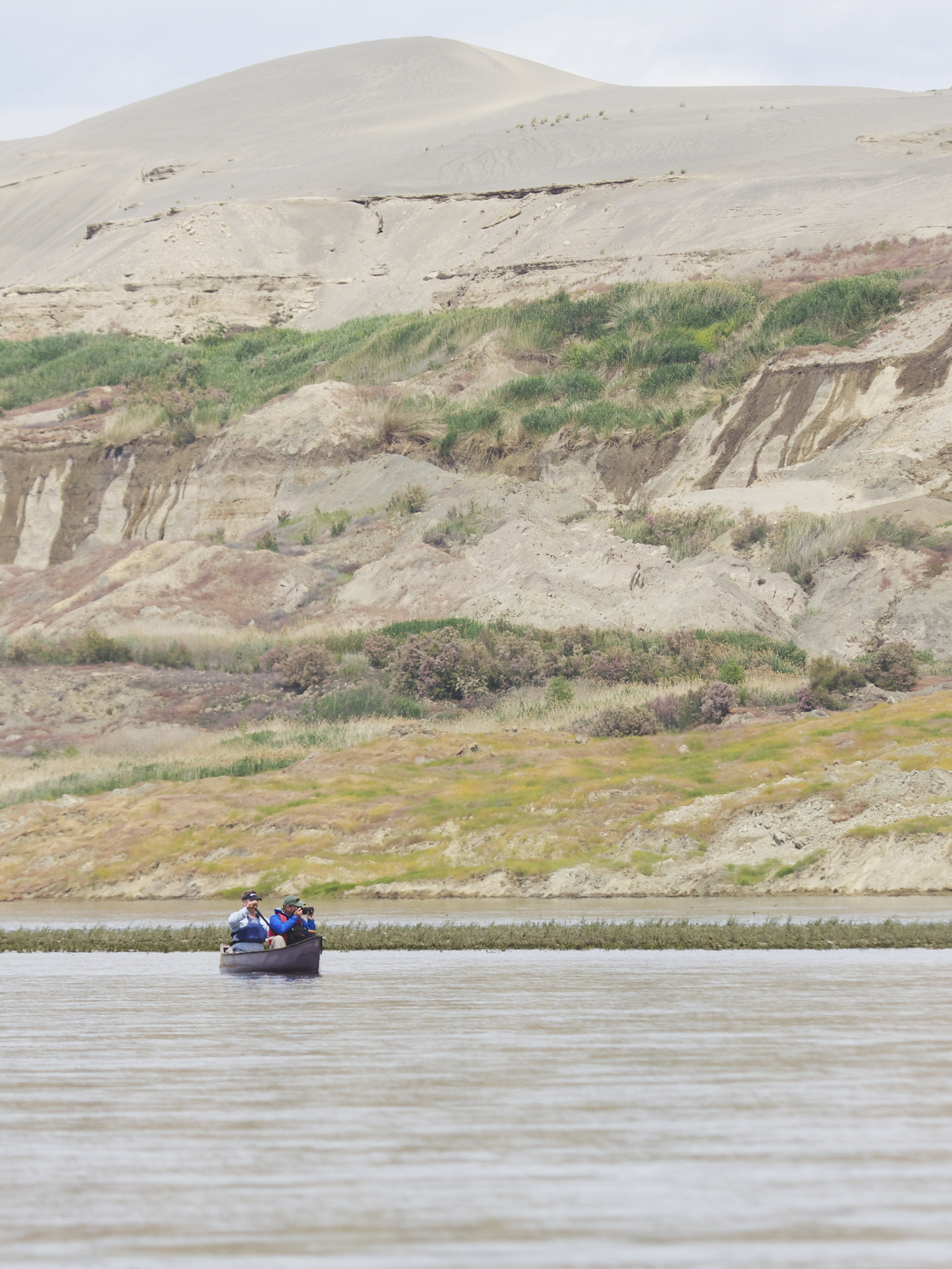 Canoeing on the Columbia River below the bluffs of the Hanford Reach National Monument. Photo by Michael Deckert.